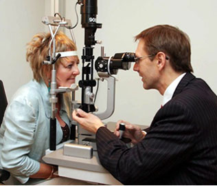 Mr Leatherbarrow examining a patient using a slit lamp